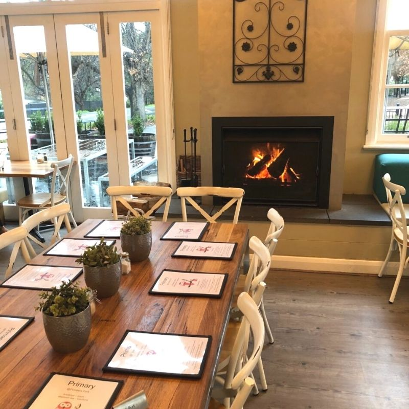 Dining table near warm fire place